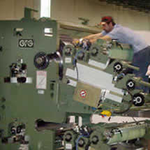 Image of GFG Service Employee working on Coater
